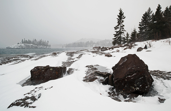 Snow Blowing on the Rocky Shoreline